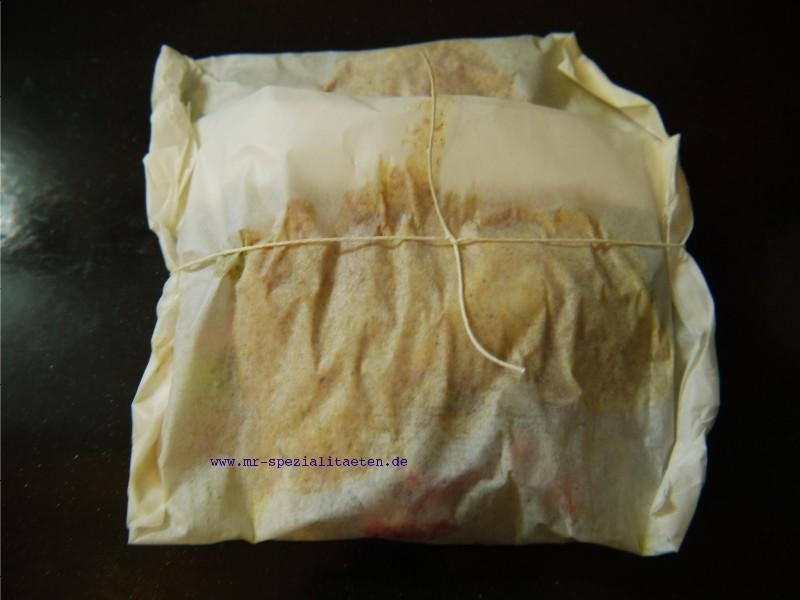 Pergamentpäckchen mit Maischolle